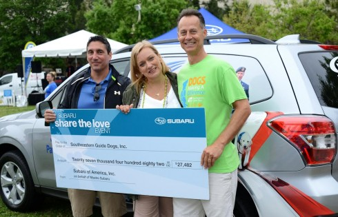 """Stephen and Stephanie Mastro of Mastro Subaru present a $27,481.69 check to Andy Kramer, vice president, philanthropy for Southeastern Guide Dogs. The money was raised by a combination of donations collected from Mastro Subaru's 2015 """"Share the Love"""" campaign and a matching gift from Subaru of America. Image/Mastro Suburu"""
